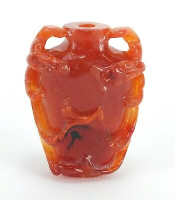 Beautiful Antique Chinese red hardstone snuff bottle, carved with bats.