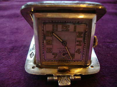 Superb condition solid silver faux snake skin covered travel clock