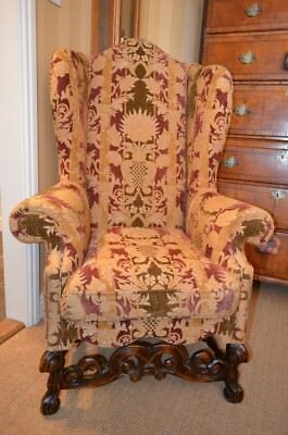 Fabulous Late 19th Century Wing Armchair with decorative carved stretchers C1890