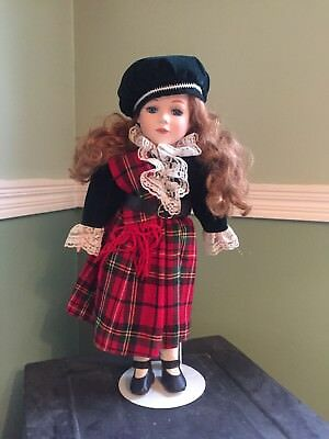 Red haired blue eyed porcelain doll. Scottish outfit