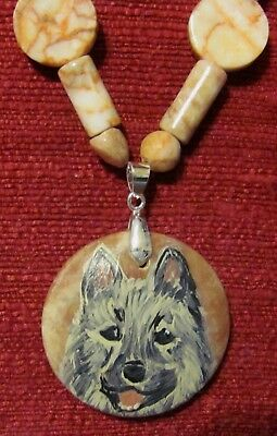 Norwegian Elkhound hand painted on a round Redline Marble pendant/bead/necklace