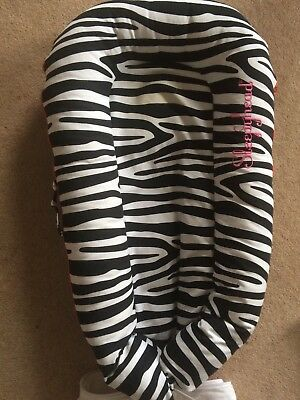Sleepyhead Deluxe baby pod with So Safari pattern cover & addtional white cover
