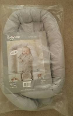 Grey Baby Dan cuddle nest/cot reducer (with original packaging)