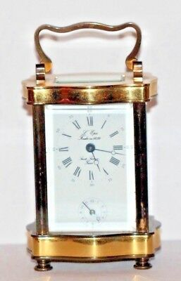 A Vintage L'epee French Serpentine Doucine 8 Day Alarm Carriage Clock