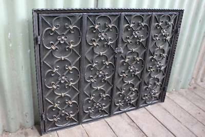 A Vintage Fitted Cast Iron & Mesh Decorative Fire Screen with Bi-Fold Doors