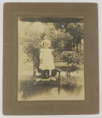 Cabinet Card Adorable little girl in white dress standing on a chair outside
