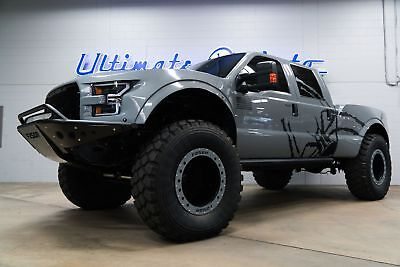 "Ford Super Duty F-250 Mega Raptor 20"" Military Wheels. F250R Raptor Body Kit. AMP Electric Steps. Pioneer/JL Audio"