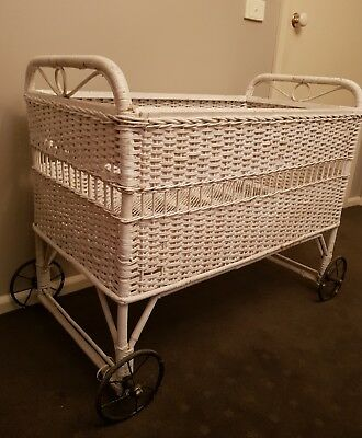 Rare Antique cane wicker cot with black wrought iron wheels