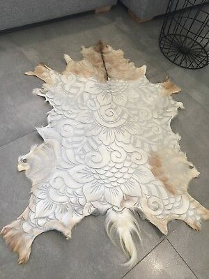 Stunning genuine hand carved goat hide rug tan and white