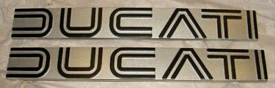 1974-79 Ducati 860GT NOS pair gas fuel tank side cover emblem badges silver