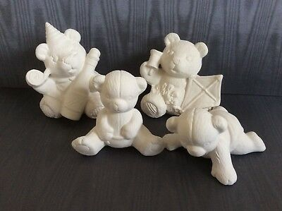 Ceramic Teddy Bears to paint. Four small unpainted and unglazed ceramic figures.