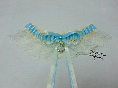 Ivory and blue dragon with opal Wedding garter. something blue garter