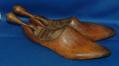A useful pair of vintage wooden shoe trees with rear knob handles, about sz 8.5