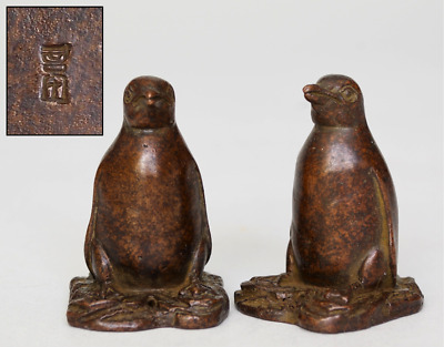 Chinese Pair of 'Scholars' Bronze Penguin Scroll Weights (+ mark), Qing dynasty