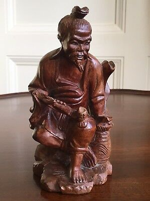 A Chinese Carved Wood Figure, Qing, 19th Or Early 20th Century.