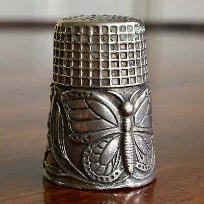 A Silver Thimble, Butterfly And Flower Decoration. Interior Gilding. 2.5cm High.