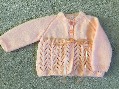 Hand Knitted Girls Cardigan in Peach Newborn