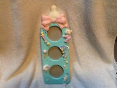 Russ Baby Bottle picture frame - holds three 2x2 pictures