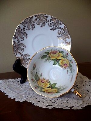 Queens Rosina Yellow Rose with red tips Gold Gilt Floral Tea Cup And Saucer