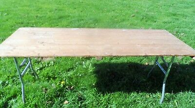 HEAVY DUTY WOODEN FOLDING TABLES  6 Feet long.  Several available.