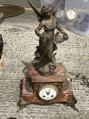 A Large French Marble And Bronze Figural Mantel Clock.