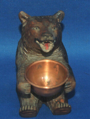 A well carved antique Victorian Black Forest sitting bear figure with bowl