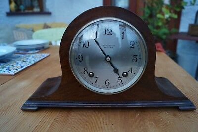 Compact Garrard Napoleon hat clock with time strike.