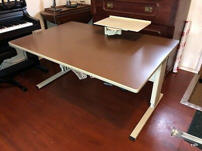 """""""co design"""" adjustable height office or computer desk with height adjustable arm"""