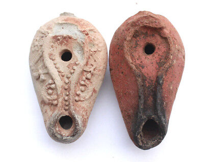 Two Ancient Byzantine terracotta oil lamps, 3rd - 4th century CE.