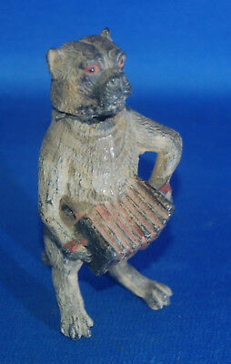An  antique Victorian cold painted metal nodder nodding pug dog musician figure