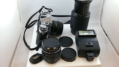 Cannon AE-1 35mm Camera with extra lenses and more