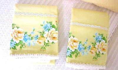 Pair of Vintage Buttercup yellow pillowcases with flowers and hand embroidered