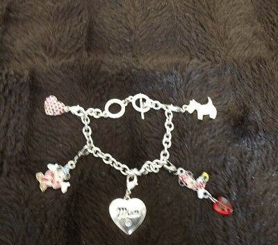 collectable Disney charm braclet and five charms bought in disney land flrorida