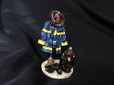 """Firefighter Figurine 5"""" coat, boots, & hydrant."""