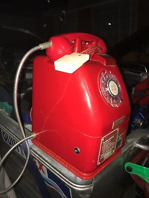 Antique red pay phone victa useable on standard landline.Perfect working order.