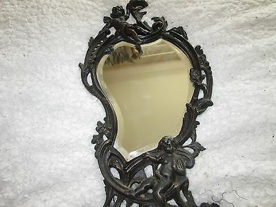 Antique french bronze footed beveled  cherub rococo style mirror
