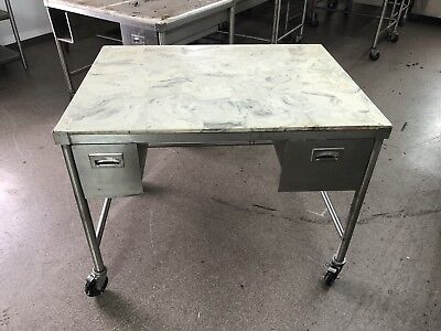 "Stainless Steel Table With Marble Top And Casters. 48"" Wide"