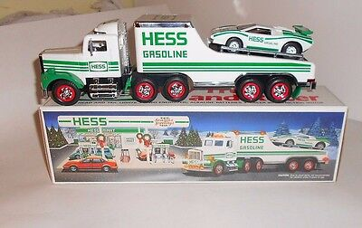HESS TRANSPORT TRUCK WITH LIGHTS PLUS RACING CAR LENGTH 30cm BY HESS NEW