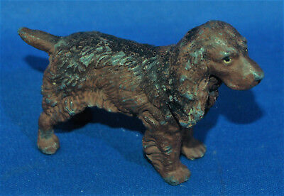 A lovely antique painted cast metal standing brown spaniel dog figure