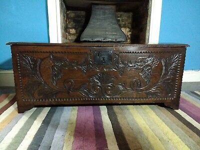 Fine 17th Century Oak Coffer Carved With Dolphins c1680.
