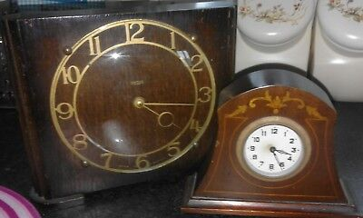 Two clocks spares or repairs