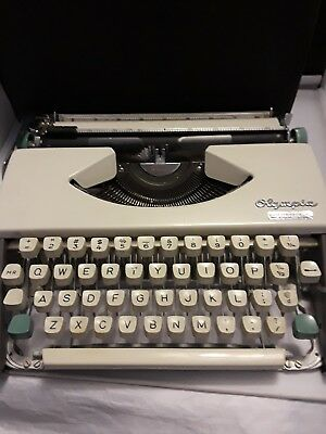 Vintage Olympia DeLuxe Portable Typewriter with Case 1960's