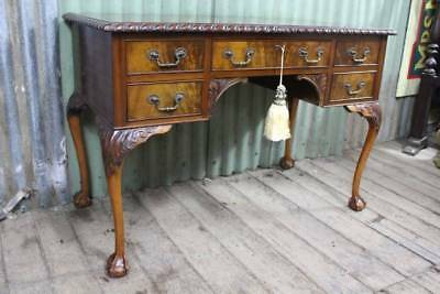A Gorgeous Flame Mahogany Antique Desk in the Georgian Chippendale Manner