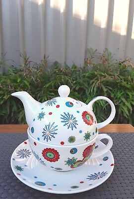 Four Piece Ceramic Tea for One Teapot Cup Saucer Hearts Flowers Starbursts