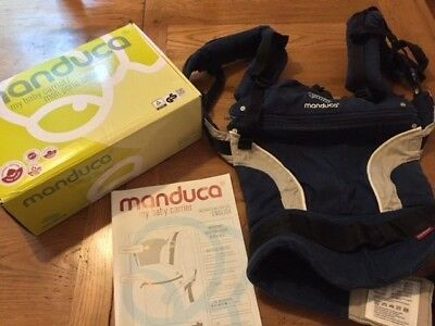 Manduca 3-in-1 baby carrier, Navy. Used. Slightly faded, but good condition.