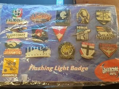 AFL - Flashing Light Badge - One is missing & some are loose - Not sure it works