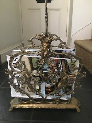 Antique French brass magazine rack with ornate scroll and cherubs