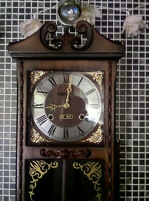 vintage 30 day wall clock by president with key & pendulum