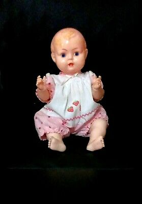 Cute vintage baby doll with clicking tongue