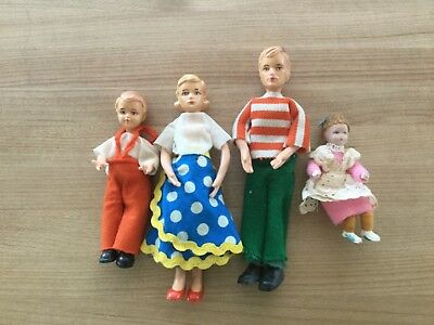 Vintage family of dollhouse people (used)